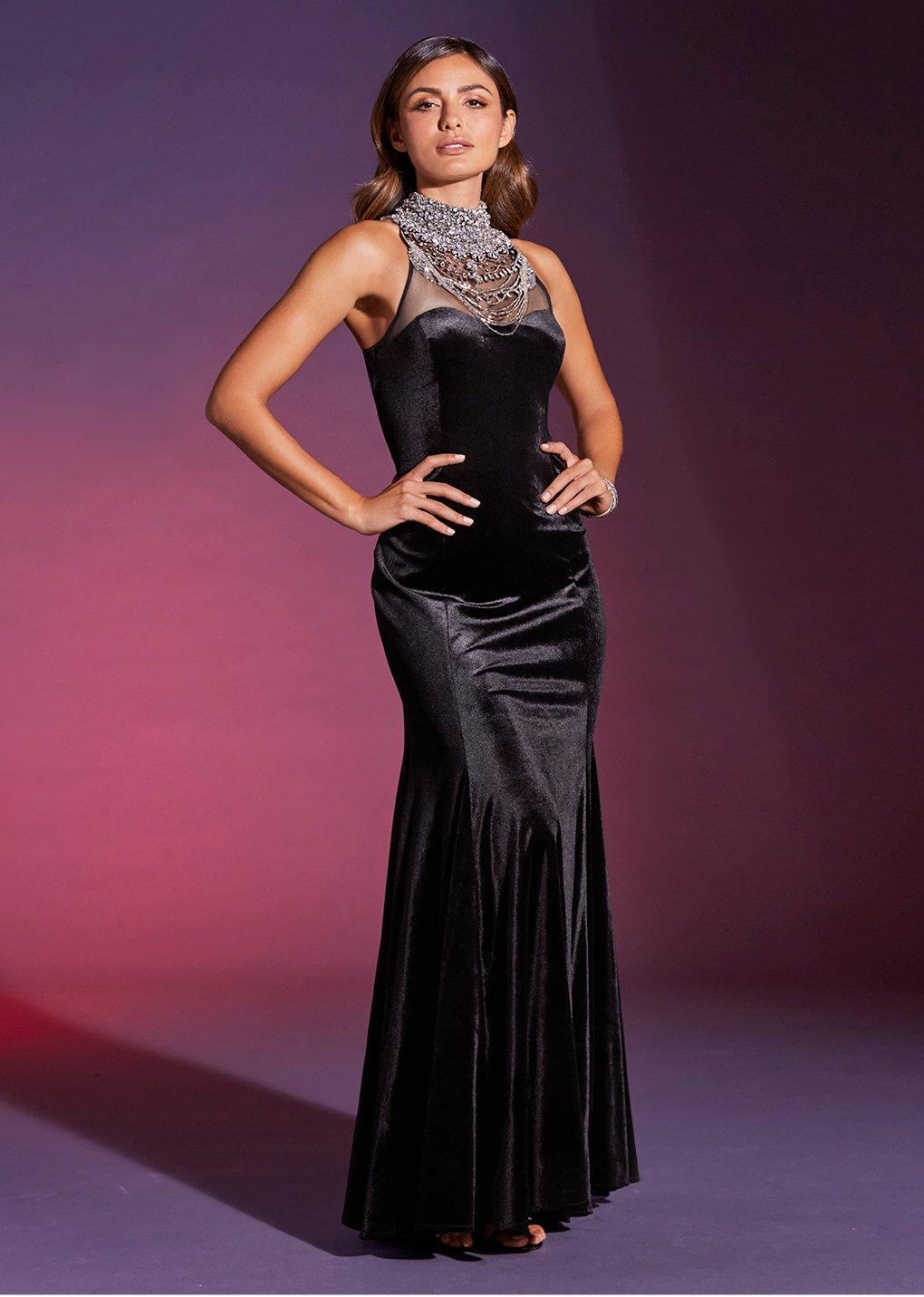 model wearing black illusion gown with jewel embellished neckline