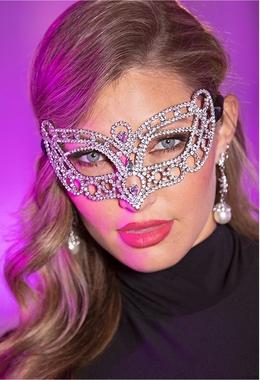 model wearing a jeweled masquerade mask