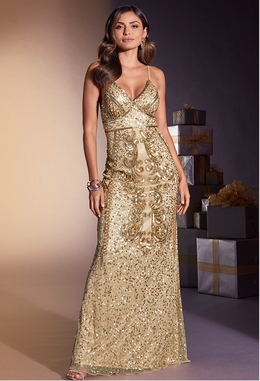 model wearing a gold sequin embellished gown