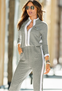 model wearing a gray and white sports jumpsuit