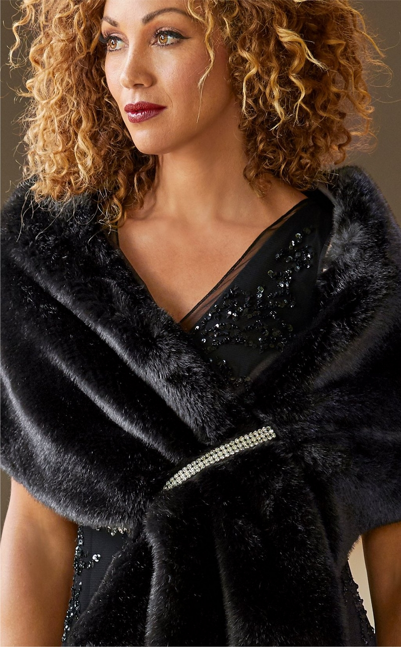 model wearing a faux fur black shawl with silver embellishments