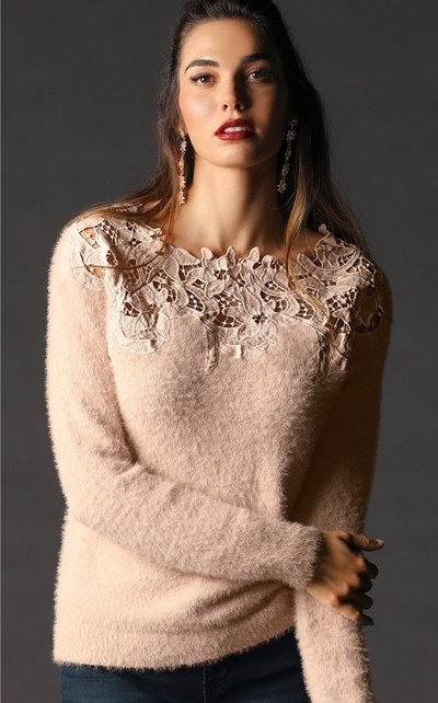 model wearing blush sweater with floral neckline
