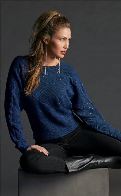 model wearing navy blue sparkly sweater over black leggings an mid-calf black boots