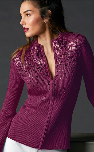 model wearing purple zip up sweater with sequins along the top half
