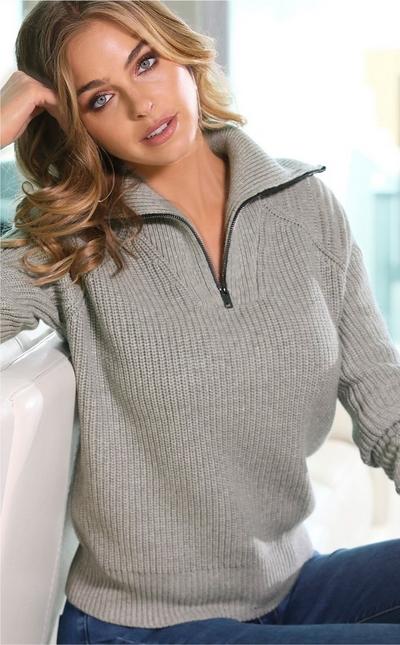 model wearing quarter zip gray ribbed sweater