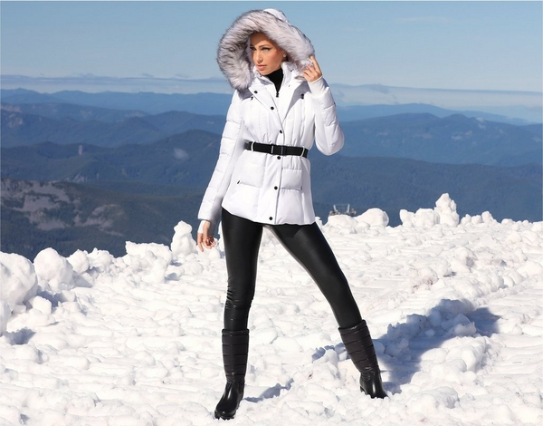 model wearing white faux fur puffer jacket over black leggings and black boots