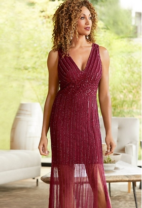 model wearing sparkly red fringe dress with fringe to the floor