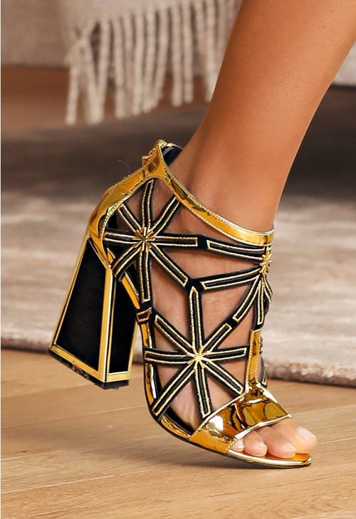 black and gold stacked heel shoe