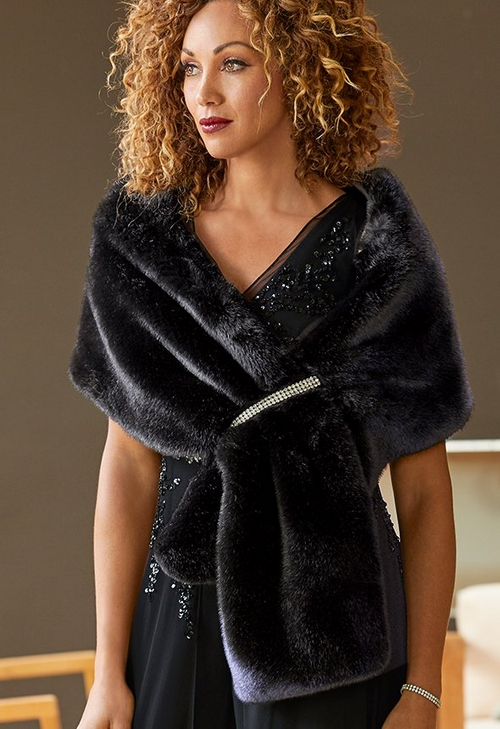 model wearing faux fur shawl with diamond embellishment
