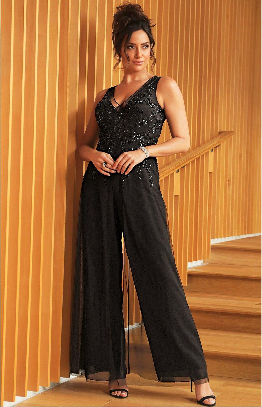 model wearing black jumpsuit with sequin embellished top