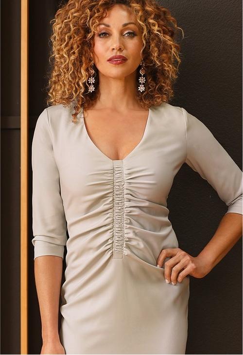 model wearing beige ruched dress