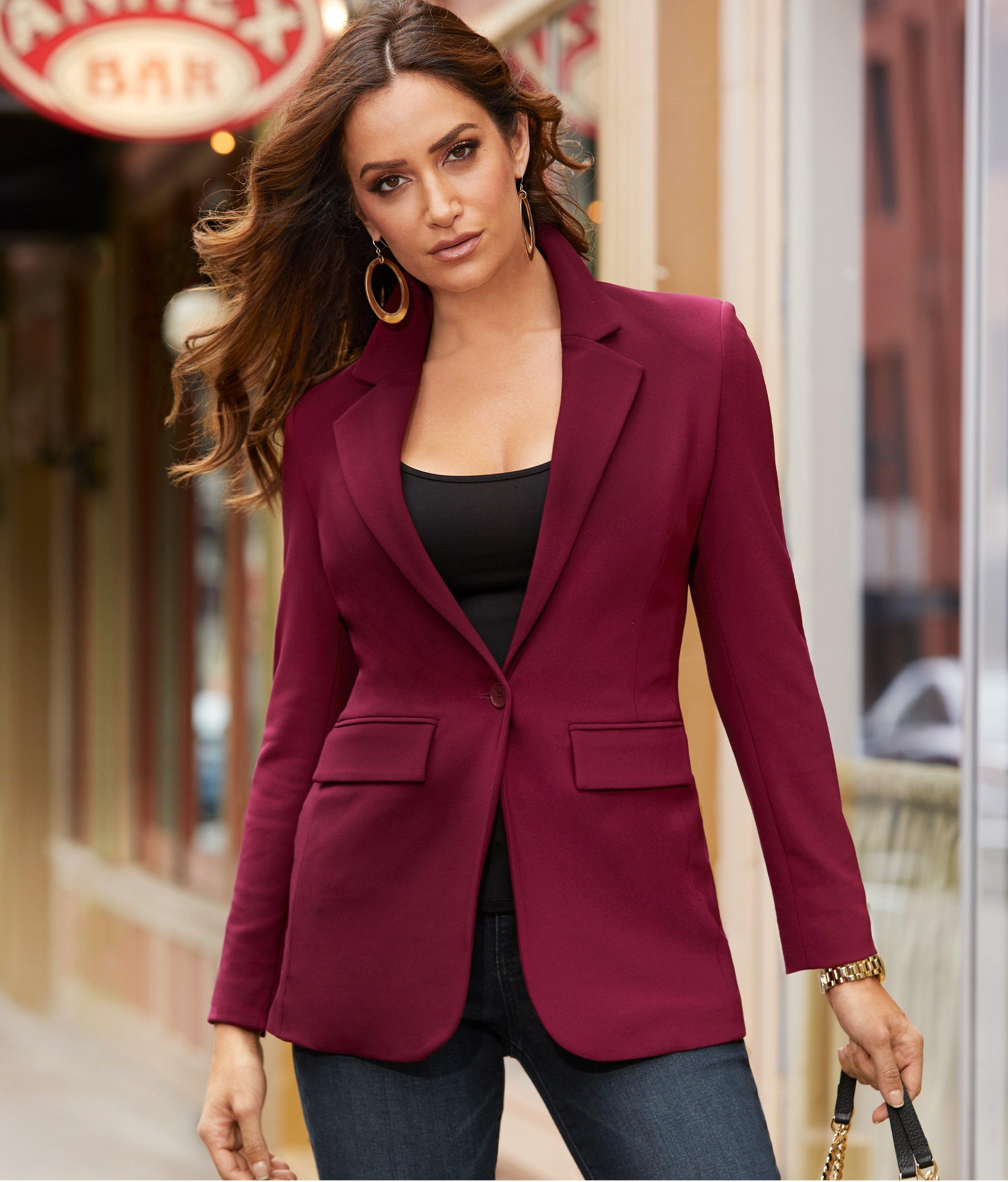 model wearing wine colored blazer over a black tank top and jeans