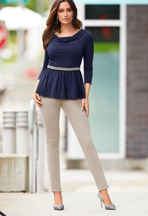 model wearing navy baby doll top with silver embellishments over tan, velvet pants