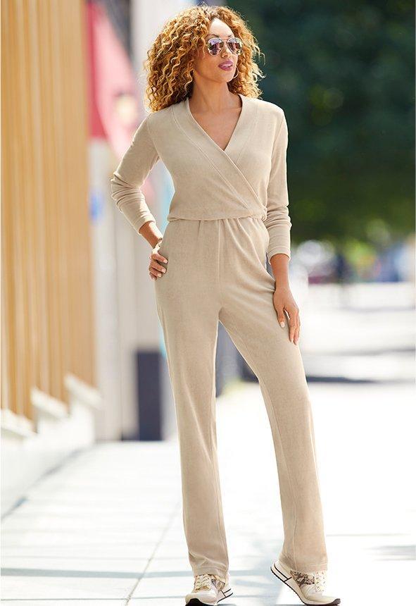 model wearing a sporty tan jumpsuit