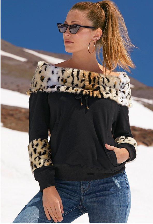model wearing off the shoulder black sweatshirt with leopard faux fur