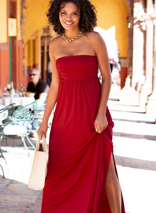 model wearing a red sleeveless maxi dress and gold chain necklace.
