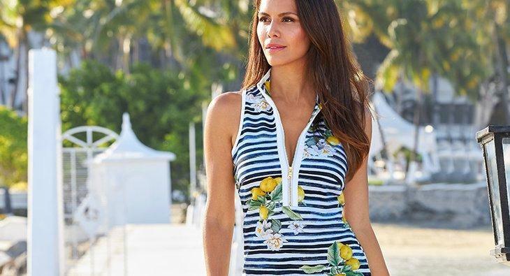 model wearing a sleeveless striped lemon print zipper sport dress.