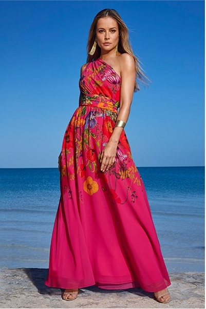 model wearing a pink floral printed one-shoulder gown.