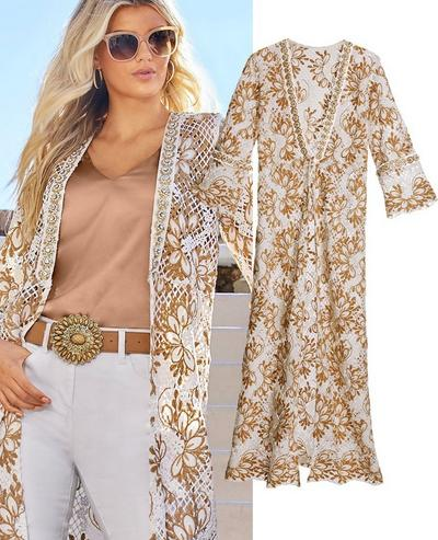 model wearing a gold and white lace embellished duster, tan v-neck top, brown embellished belt, white jeans, and sunglasses.