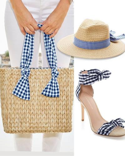 accessories shown: straw bag with navy gingham ribbon handle, straw hat with navy gingham ribbon, navy gingham bow heels.