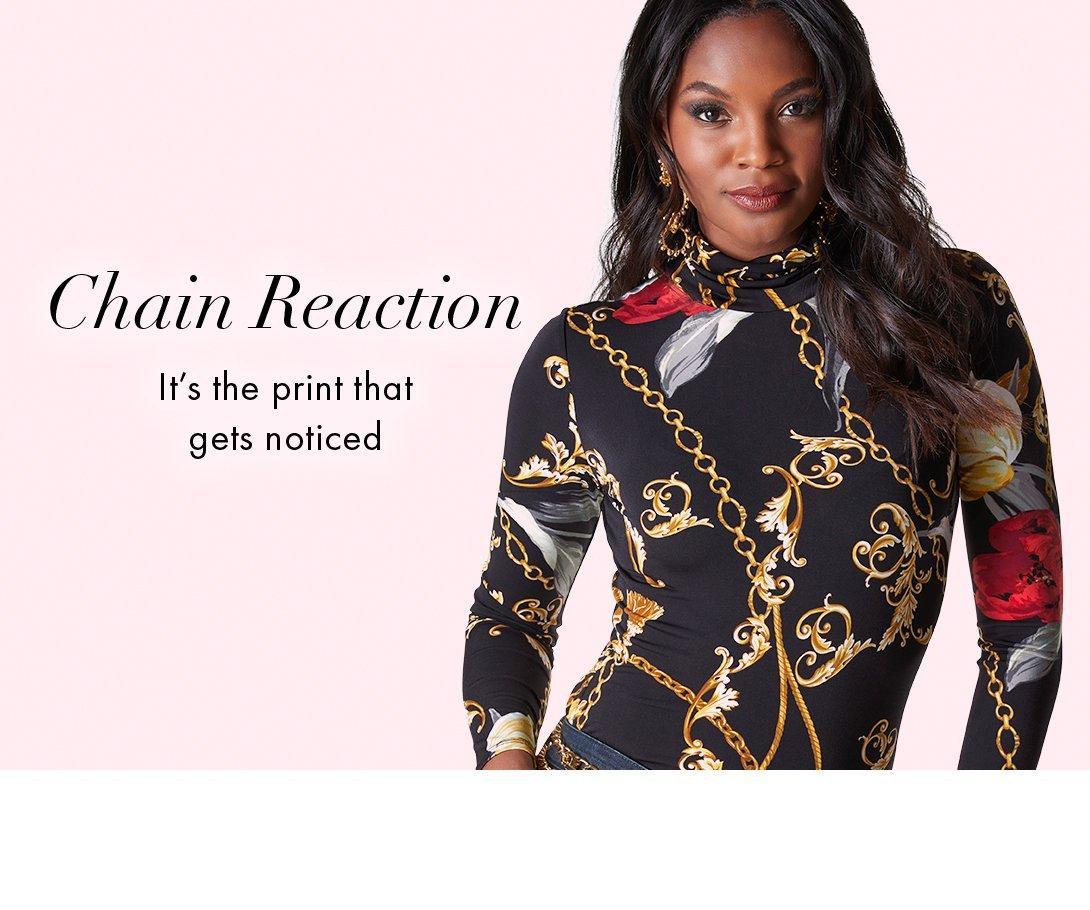 model wearing a black status print long-sleeve turtleneck top. left text: chain reaction. it
