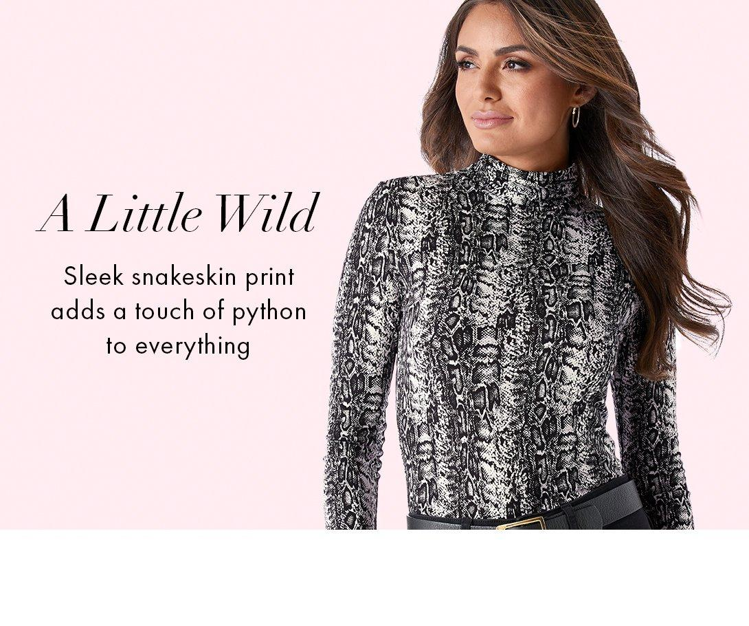 model wearing a black and white python print long-sleeve turtleneck top. left text: a little wild. sleek snakeskin print adds a touch of python to everything.