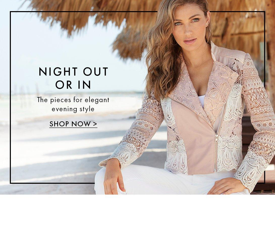 model wearing a blush and white lace jacket, white tank top, and white pants.