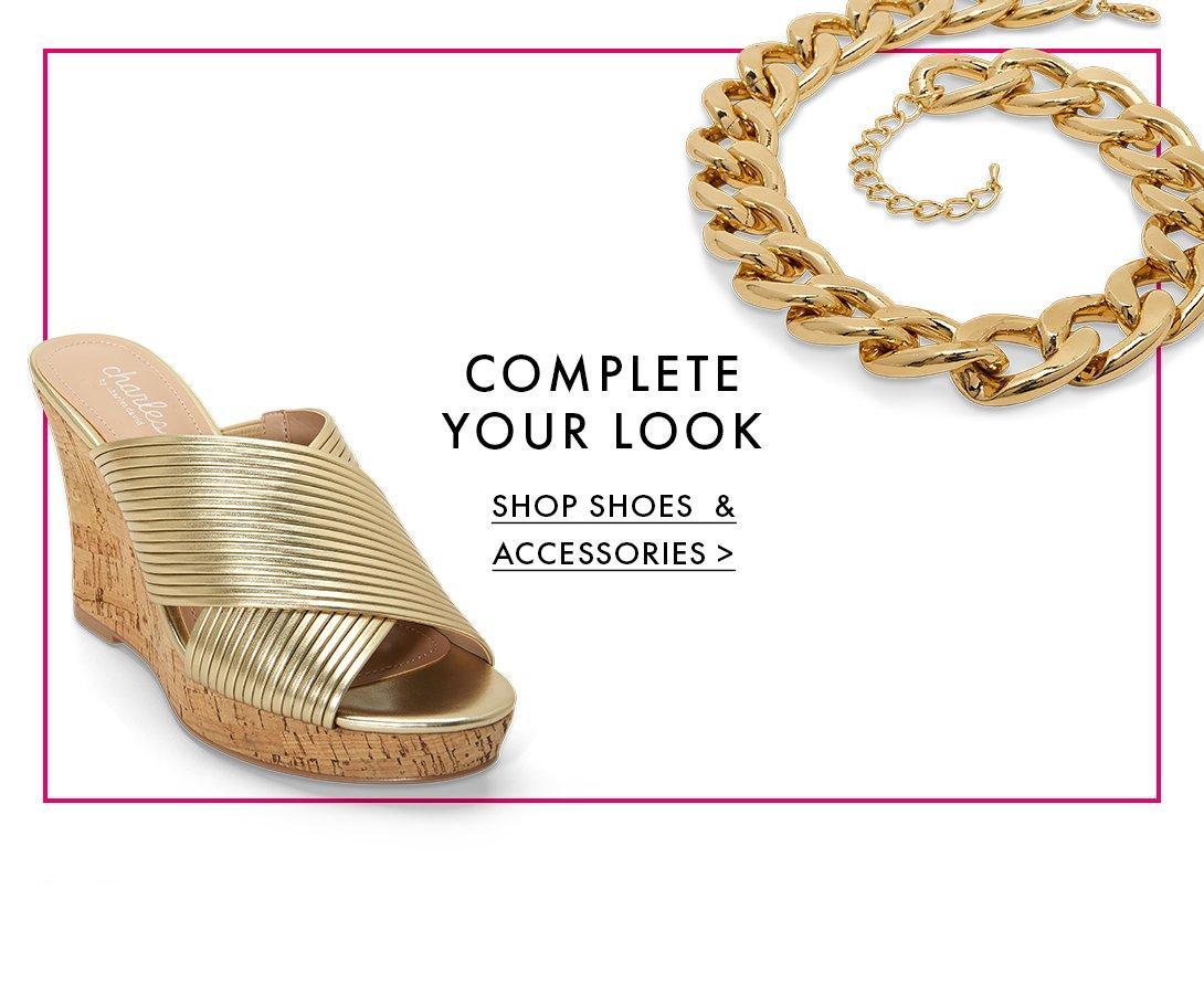 gold metallic crisscross cork wedge and a thick gold chain necklace.