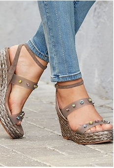 model wearing jeweled espadrille wedges.