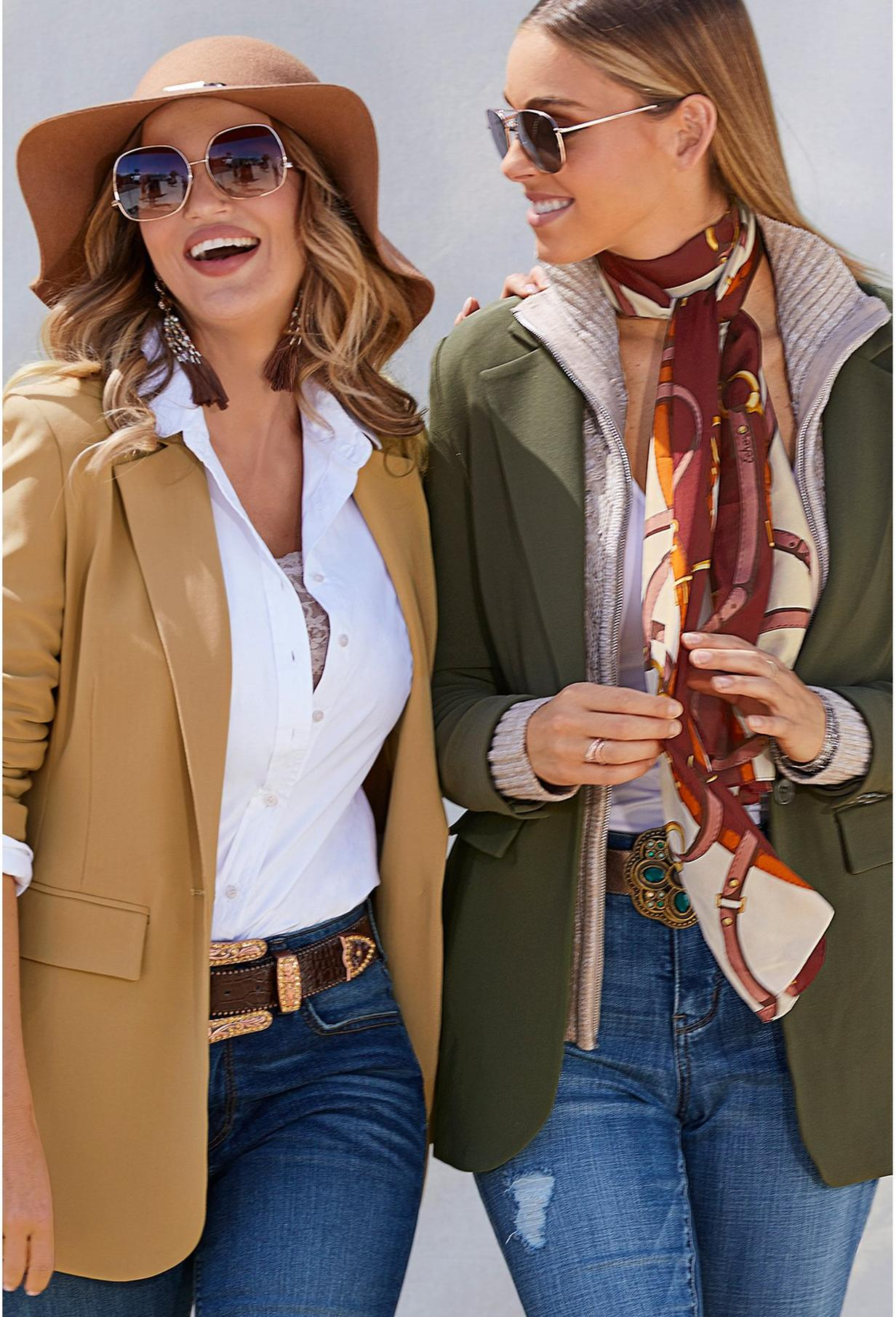 two women wearing blazers, jeans, and poplin tops