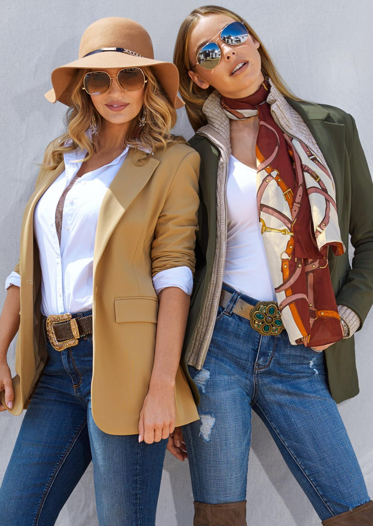 two women with blazers over a poplin top and jeans