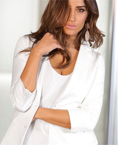 model wearing a white twill blazer and a white tank top.