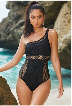 model wearing a one-shoulder, one-piece, black crochet swimsuit