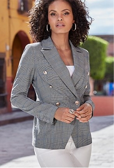 model wearing a gray plaid blazer, white tank top, and white jeans.