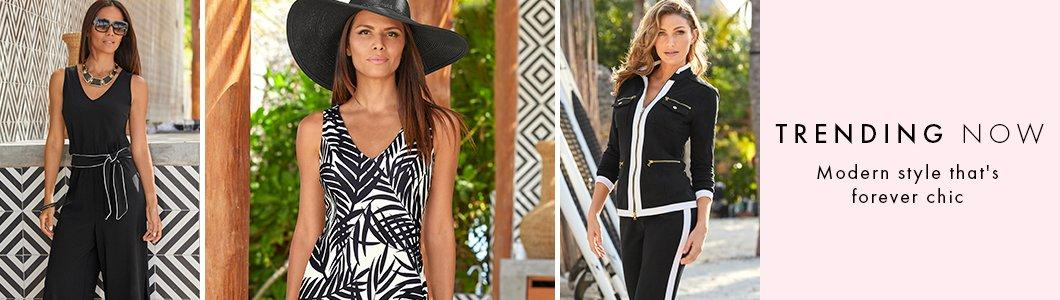 left model wearing a black sleeveless jumpsuit with a black belt with white piping, sunglasses, and a gold necklace. middle model wearing a black and white palm print v-neck maxi dress and a black floppy hat. right model wearing a black and white chic-zip two-piece set.