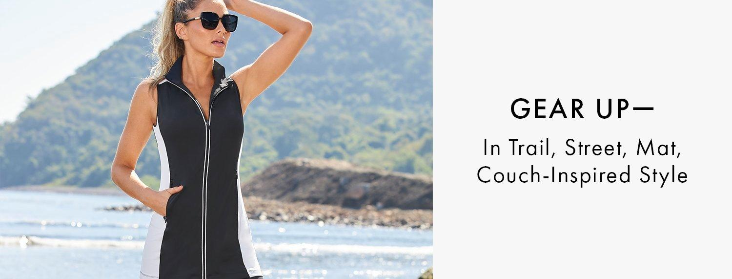 model wearing a black and white color block sleeveless sport dress and sunglasses. Gear Up - in trail, Mat, Couch-inspired style.
