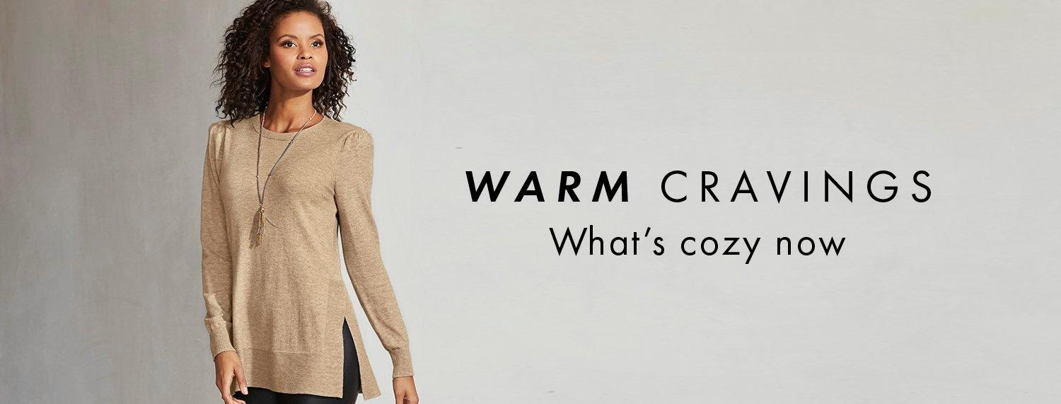 text: warm cravings. what's cozy now. model wearing an oatmeal side-slit puff-sleeve sweater.