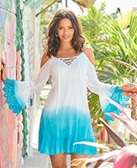 model wearing a blue and white tie-dye flare-sleeve cold-shoulder dress with lace embellished sleeves and a lace up neckline.