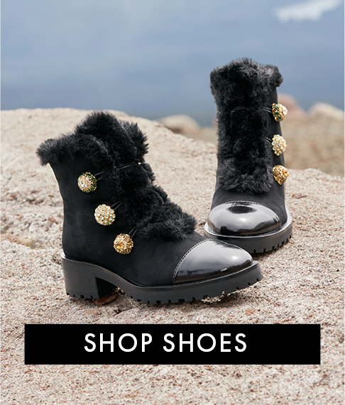 black faux-fur lace-up boots with gold buttons.