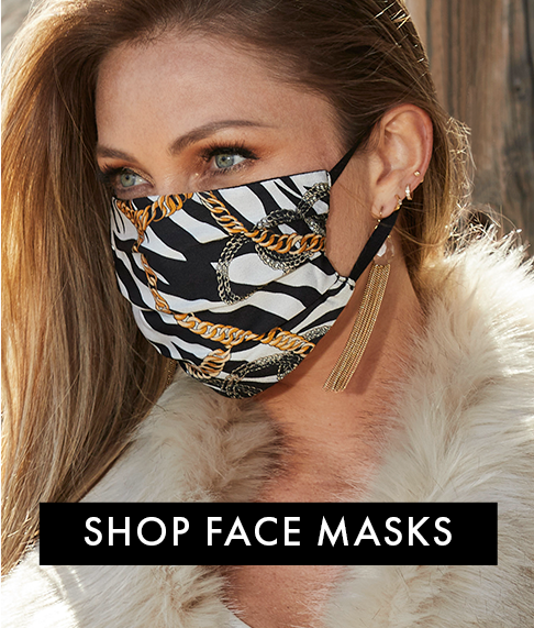 model wearing a black and white zebra print and chain design face mask.