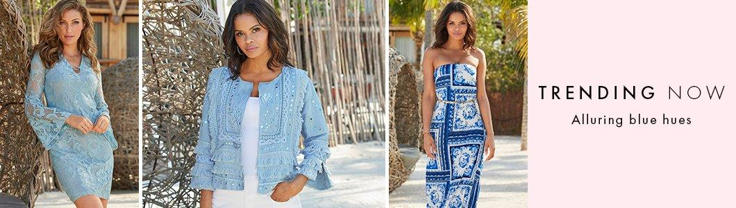 left model wearing a light blue lace flare-sleeve dress. middle model wearing a light blue fringe and mirrored jacket, white tank top, and white jeans. right model wearing a blue and white tile print strapless maxi dress with a gold belt around the waist.