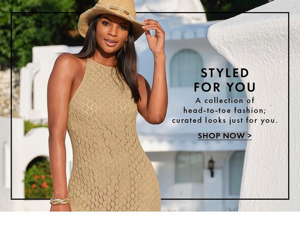 model wearing a tan crochet high-neck sleeveless maxi dress and straw hat.