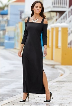 model wearing a black cold-shoulder maxi dress with a metal necklace and black pumps.