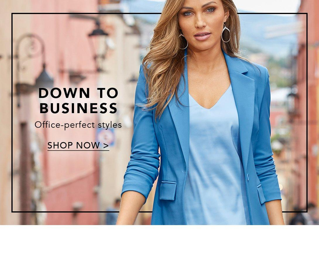 model wearing a blue blazer and light blue v-neck tank top.